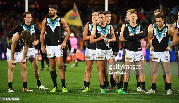 Power players look on dejected after the round 20 AFL match between the Adelaide Crows and the Port Adelaide Power at Adelaide Oval on August 6 2017...