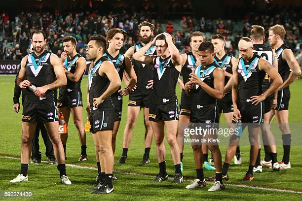 Power players react after losing in the round 22 AFL match between the Port Adelaide Power and the Adelaide Crows at Adelaide Oval on August 20 2016...