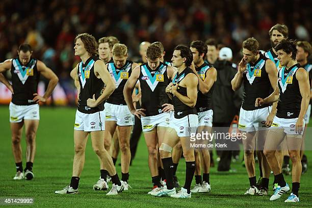 Power players react after the round 15 AFL match between the Adelaide Crows and the Port Adelaide Power at Adelaide Oval on June 29 2014 in Adelaide...