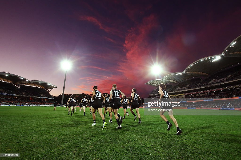 Power players run onto the field for the start of the second half during the round seven AFL match between the Port Adelaide Power and the Brisbane Lions at Adelaide Oval on May 8, 2016 in Adelaide, Australia.