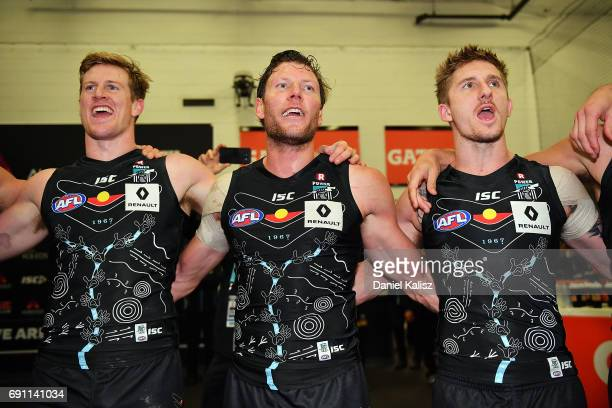 Power players sing the club song after defeating Hawthorn during the round 11 AFL match between the Port Adelaide Power and the Hawthorn Hawks at...