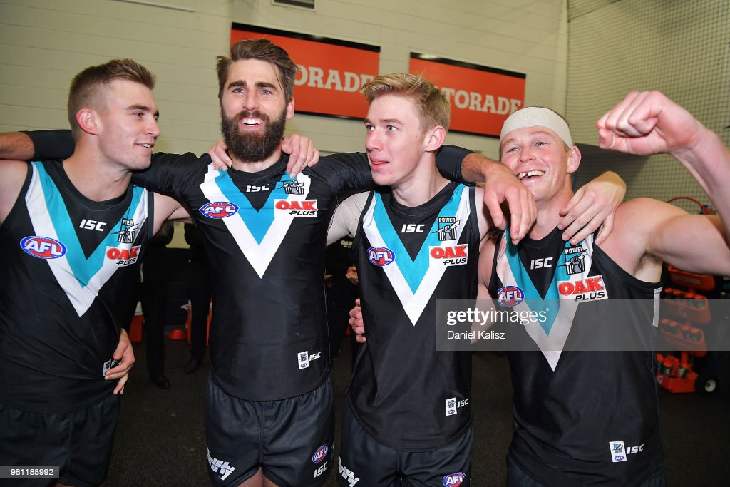Power players sing the club song after defeating the Melbourne Deamons during the round 14 AFL match between the Port Adelaide Power and the Melbourne Demons at Adelaide Oval on June 22, 2018 in Adelaide, Australia.