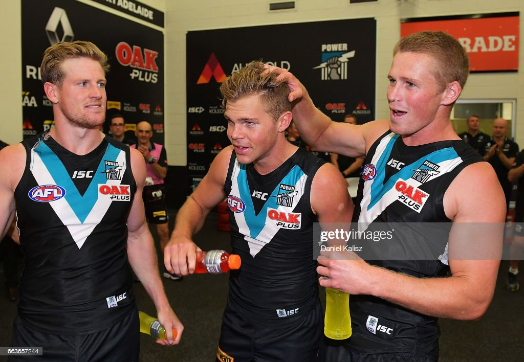 Power players sing the club song after the round two AFL match between the Port Adelaide Power and the Fremantle Dockers at Adelaide Oval on April 2, 2017 in Adelaide, Australia.