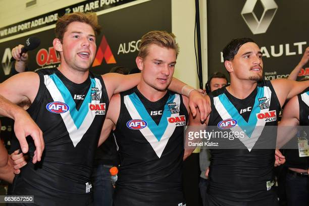 Power players sing the club song after the round two AFL match between the Port Adelaide Power and the Fremantle Dockers at Adelaide Oval on April 2...