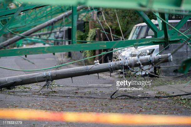 A power pole and golf practice range fences collapsed to houses are seen following the passage of Typhoon Faxai on September 09 2019 in Ichihara...
