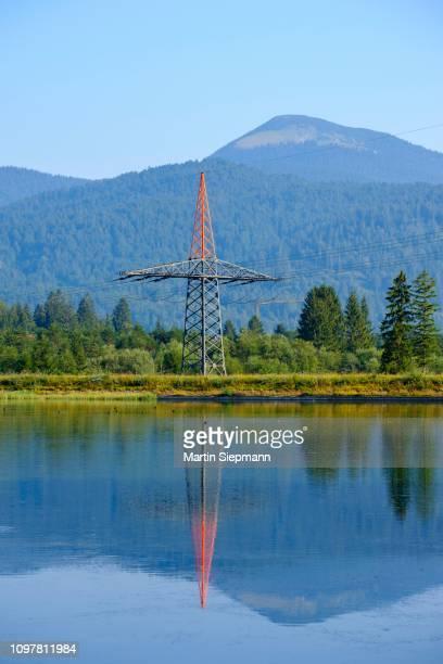 power pole and high-voltage line, isar reservoir kruen, werdenfelser land, upper bavaria, bavaria, germany - krün stock-fotos und bilder