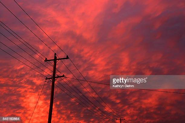 power pole and lines with clouds