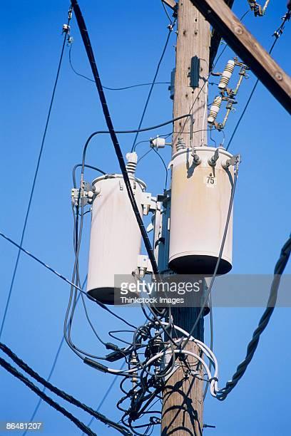 power pole with transformers - thinkstock stock-fotos und bilder