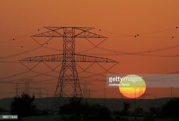 Power poles are seen during sunset on January 11 2006 in Dubai United Arab Emirates