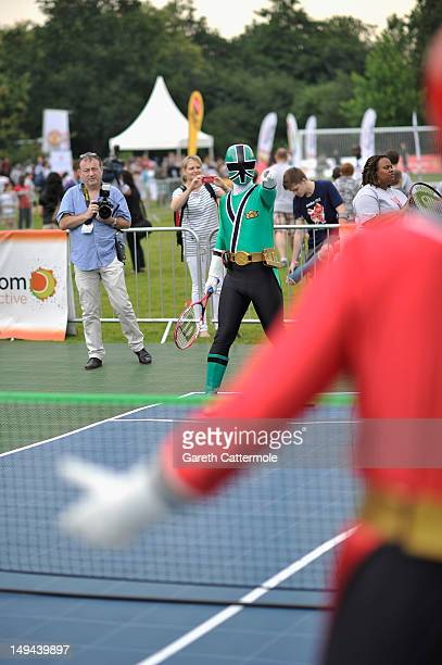"""Power Rangers play tennis at First Lady Michelle Obama's """"Let's Move!"""" campaign event at the US Ambassador to the UK Louis Susman's estate on July..."""