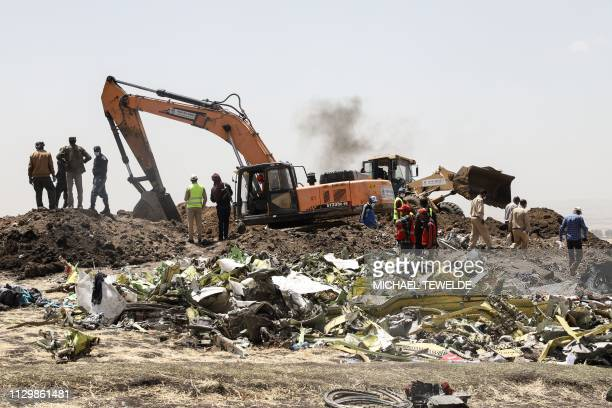 A power shovel digs at the crash site of Ethiopia Airlines near Bishoftu a town some 60 kilometres southeast of Addis Ababa Ethiopia on March 11 2019...