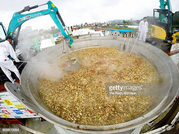 Power shovels are used to stir a 6meter huge wok to cook 'Imoni' stewed potatos and distribute during Japan's Biggest 'ImoniKai' Festival at the foot...