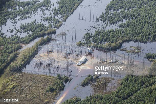 A power station covered in floodwater is seen in this aerial photograph taken above Willard North Carolina US on Friday Sept 21 2018 Record floods...