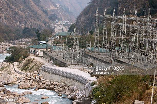 A power station stands at the site of the Punatsangchhu hydroelectric power project in Wangdue Bhutan on Saturday Feb 11 2012 Bhutan with a...