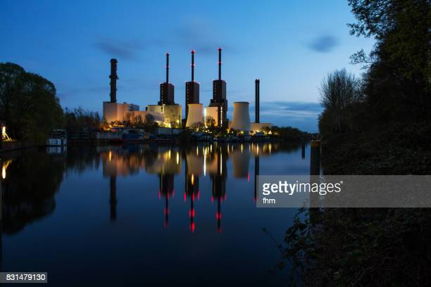 Power station with smoking stacks and nice reflection in  the water at blue hour (Berlin, Germany)