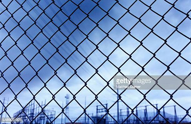 Power sub-station behind chain link fence