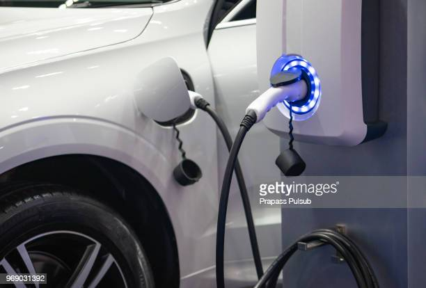 power supply for electric car charging. electric car charging station - electric vehicle charging station stock photos and pictures