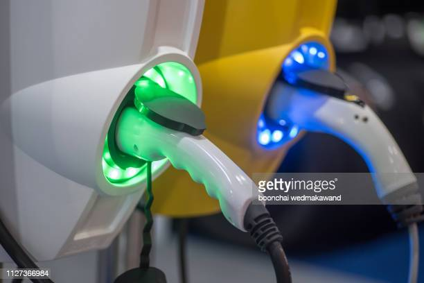 power supply for electric car charging. electric car - station stock pictures, royalty-free photos & images
