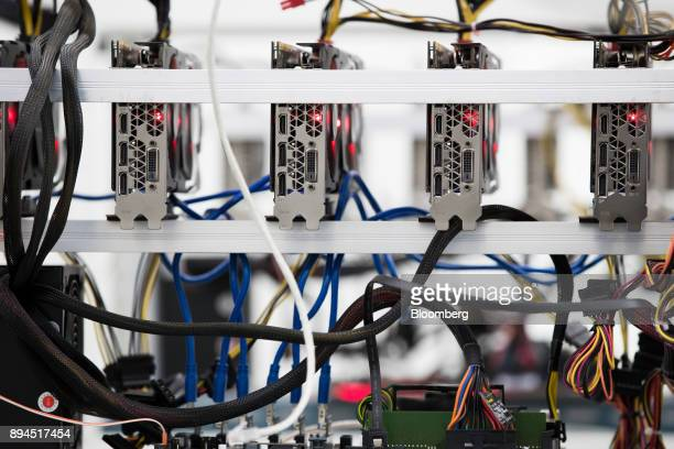 Power supply units and cooling fans sit on shelves at a cryptocurrency mining facility in Incheon South Korea on Friday Dec 15 2017 Hedge funds are...