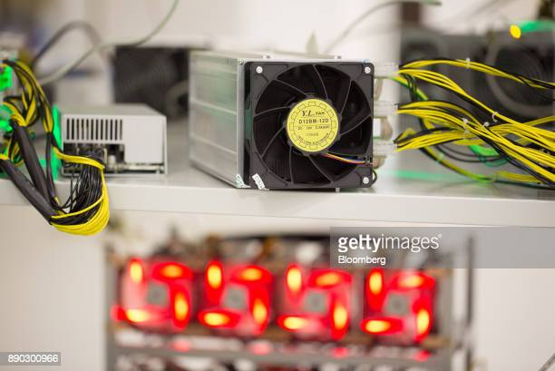 Power supply units and illuminated cooling fans sit on shelves linked to cryptocurrency mining machines at the SberBit mining 'hotel' in Moscow...