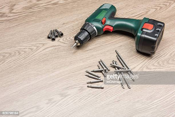 power tool on the wood table - drill stock pictures, royalty-free photos & images