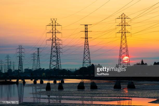 Power transmission tower is silhouetted by the rising sun in Burlingame, California on October 26, 2019. Potentially historic windstorm coming to the...