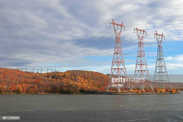 Power Transmission towers and lines in Quebec, Canada as seen from Saint Lawrence river