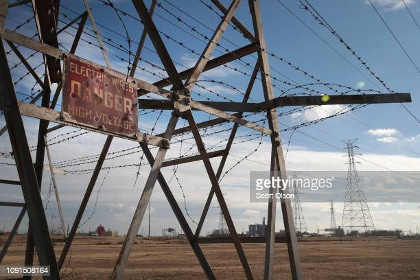 Power transmission towers run along the IndianaIllinois border on January 08 2019 in Hammond Indiana Despite a large drop coalfired power plants...