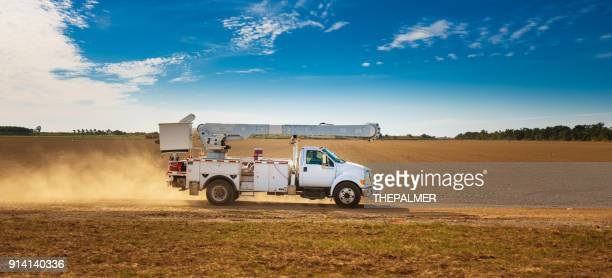 power utility bucket truck - fuel and power generation stock pictures, royalty-free photos & images