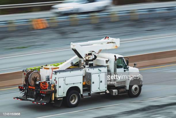power utility truck en route - fuel and power generation stock pictures, royalty-free photos & images