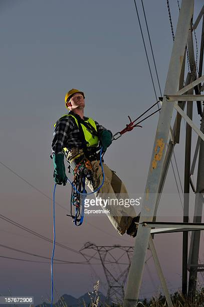 power utility worker abseiling from pylons - safety harness stock photos and pictures