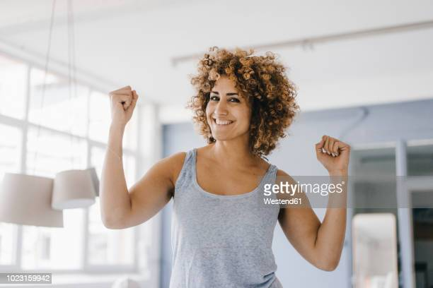 power woman flexing muscles, portrait - flexing muscles stock pictures, royalty-free photos & images