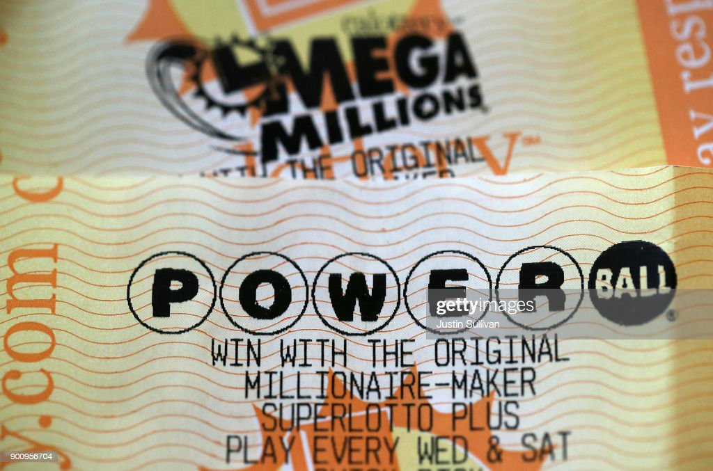 Powerball and Mega Millions lottery tickets are displayed on January 3, 2018 in San Anselmo, California. The Powerball jackpot and Mega Millions jackpots are both over $400 million at the same time for the first time. The Mega Millions $418 million jackpot would be the fourth largest and the $460 million Powerball jackpot would be the seventh largest in the game's history.