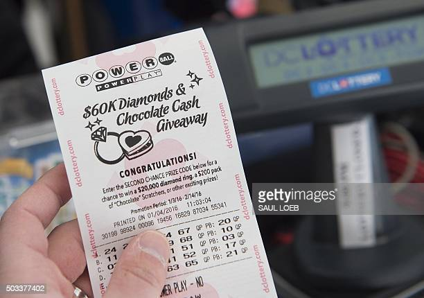 A Powerball lottery ticket is seen at a liquor store in Washington DC January 4 2016 Lottery officials predict the January 6 jackpot will reach $400...