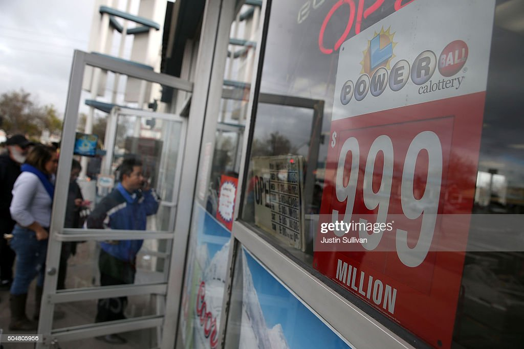 A Powerball sign is posted in the window Kavanagh Liquors on January 13, 2016 in San Lorenzo, California. Dozens of people lined up outside of Kavanagh Liquors, a store that has had several multi-million dollar winners, to -purchase Powerball tickets in hopes of winning the estimated record-breaking $1.5 billion dollar jackpot.