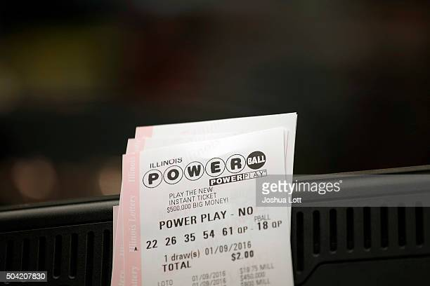 Powerball tickets rest on a 7Eleven store register January 9 2016 in Chicago Illinois The Powerball Jackpot Surged to a record $900 Million in 44...