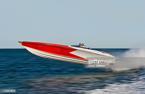powerboat racing at high speed - nautical vessel stock pictures, royalty-free photos & images