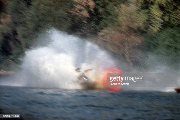 Outboard Motor Championship Hap Owen's Class F hydroplane flips and crashes during race on the Wabash River Mount Carmel IL CREDIT Richard Meek
