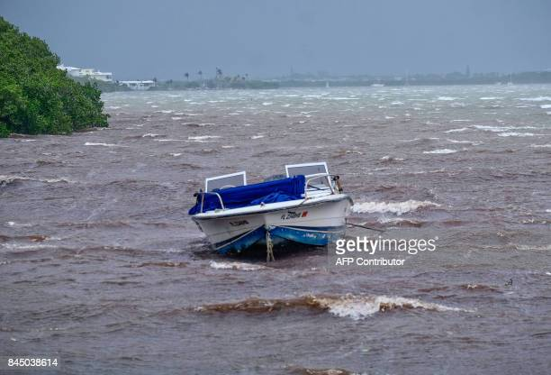A powerboat sits moored in shallow rough seas in the Florida Keys as winds and rain from the outer bands of Hurricane Irma arrive in Islamorada...