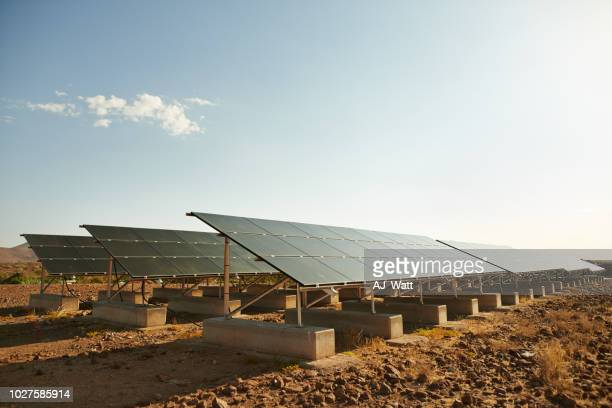 powered by nature - solar panels stock photos and pictures