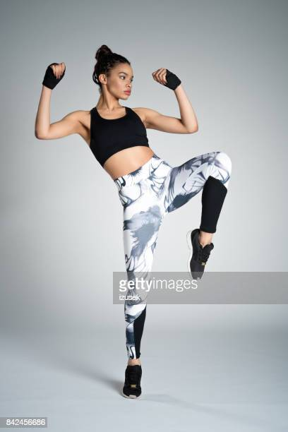 powerful afro american young woman in sports wear, studio shot - sports clothing stock pictures, royalty-free photos & images