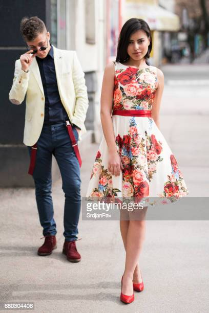 powerful attraction - men wearing dresses stock photos and pictures