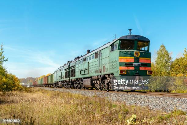 powerful diesel locomotive with freight train - cargo train stock photos and pictures