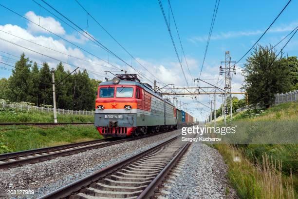 powerful electric locomotive with short container train - 貨物列車 ストックフォトと画像