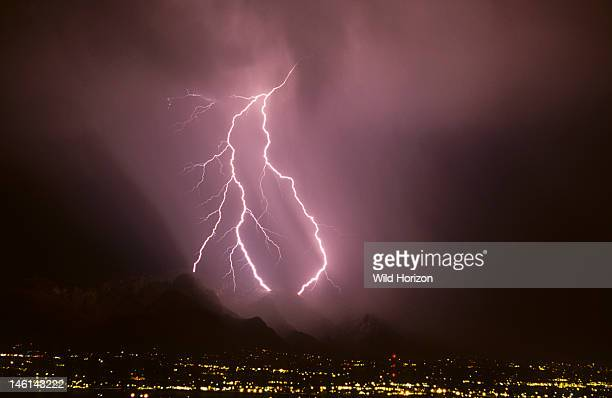 Powerful forked cloudtoground lightning discharge with three strike points in the Santa Catalina Mountains Tucson Arizona USA