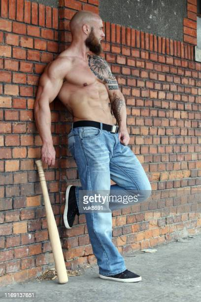 powerful hooligan with baseball bat - sexy male torso stock pictures, royalty-free photos & images