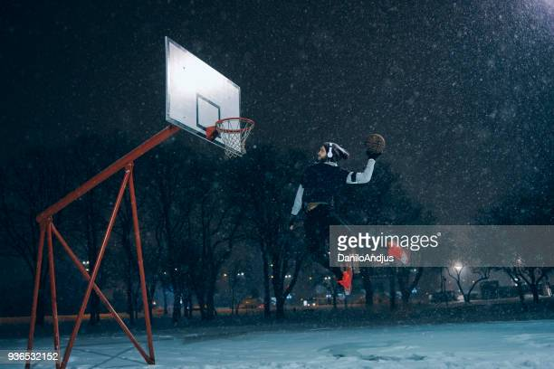 powerful image of an athlete man slam dunking