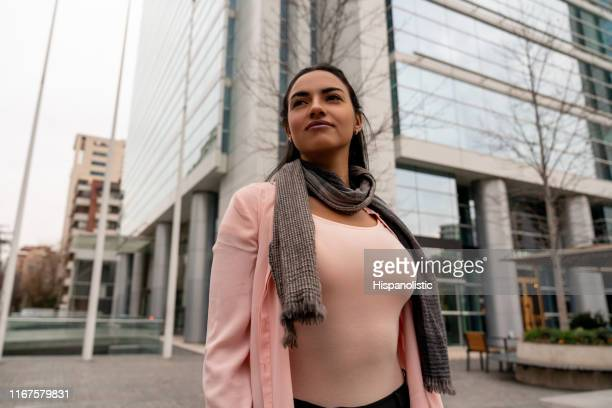 Powerful latin american businesswoman looking away thoughtful