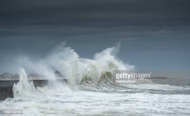 powerful storm against the coast and the harbor in the south of brittany - retaining wall stock pictures, royalty-free photos & images