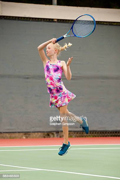 powerful tennis forehand by a small girl